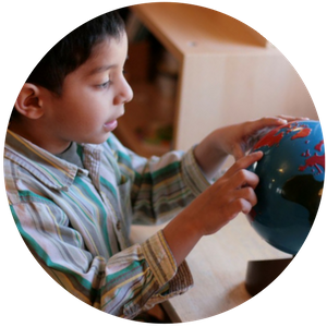 Learning about the globe at Trillium Montessori preschool in Cary, NC 27519; also serving Apex, Morrisville and western Wake County